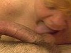 This aged redhead gives a long hot blowjob. Engulfing and licking ramrod and working his balls hard until that fellow discharges his hot load of cum.