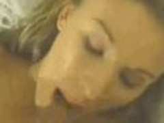 Brilliantly sexy woman acquires screwed between her big nice mangos with dark giant cock, sliding along her chest.