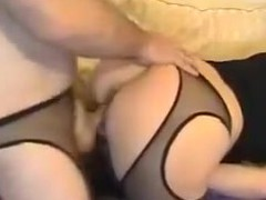 This kinky pair has a kink for filming themselves and wearing fetish outfits. With cut stockings on, they fuck hard in doggy style position until the woman groans in pleasure.