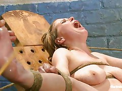 Her moaning and screaming won't help this bitch to much. The executor wants to make her muff soaked even if it means to spank and use water jets on it. This babe is tied with her sexy legs spread and her pink, hairless vagina is at fully display. Perhaps this babe will squirt if the man keeps it up that way