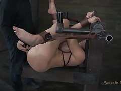 Kelly Divine is tied up with her arse up like a whore. The executor is eager to stick his dick in her but first that chap wishes to be sure that Kelly is all wet and ready for cock. That chap fingers her so mean that that honey makes herself soaking wet and then that chap starts drilling her. Do you think that chap will cum in her pussy?