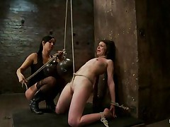 This is hawt and only gets better, a dominating milf wearing nylons and sexy clothing is showing a younger angel who's the boss. That babe ties her with rope and as the rope goes through those her pussy lips, a weight at the end of the rope makes things more interesting. The chick is suffocated too and probably that babe enjoys it a lot!