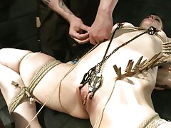 Katharine Cane is a breasty brunette milf desperately in need for punishment. Watch how Soma Snakeoil and her male friend give her what this chick wants. The hot red haired chick and her help are putting clothespins all over her body, making her scream with pleasure and pain while rubbing her pussy with a big vibrator.