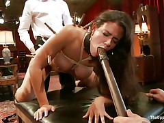 Brunette wench Penny is a slave at a sex party. This babe is made to suck hard cocks, then gets her a-hole spanked. A large vibrator will solve the situation very well, making her cunt so moist and hot. The guy sticks his dick in her pussy from behind, but she wants to suck some greater quantity and starts sucking the dildo!