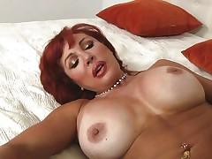 Her years of experience in fucking have a lot to say. Check out this gorgeous redhead milf and how lustfully this babe sucks and bonks cock. Damn the bitch knows how to drink a cock and when this babe goes on top and rides this guy we can clearly see her pussy lips spreading. Yep this milf needs some cock juice deep inside her