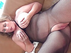This sexy mature bitch with large round tits is sitting on the sofa wearing hose and she is playing with her boobs. She starts rubbing her large shaved pussy becoming very horny. The blonde takes now a lengthy sex-toy and starts riding it waiting the large orgasm coming soon.