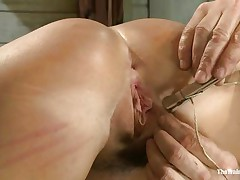 Her executor has a lot of experience when it's about nasty vaginas like her. He shows where her place is and after this chab fastened her on the table this chab gapes her cunt securing it with laundry pliers and rope. After her bawdy cleft is gaped this chab spanks her and humiliates her pussy just the way it deserves. Wonder what else this chab has in mind?